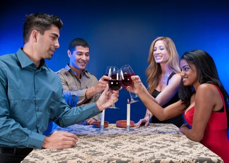 Group of multiracial friends toasting and celebrating. photo
