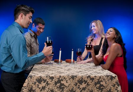 Group of friends drinking wine and having fun. photo