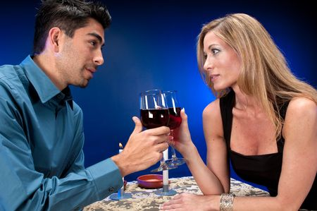 Multiracial couple dating in night club or restaurant setting. photo