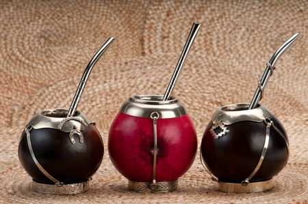 Mate: Group of calabash mate cups with straws.,Mate is a traditional drink very similar to tea in Argentina, Uruguay, Paraguay and some parts of Brazil.