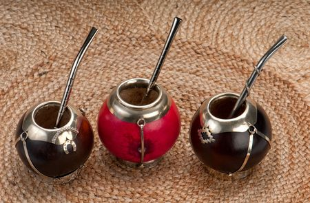 mate drink: Group of calabash mate cups with straws.,Mate is a traditional drink very similar to tea in Argentina, Uruguay, Paraguay and some parts of Brazil.