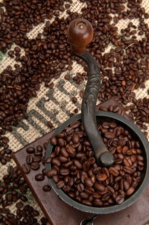 east espresso: Old Grinder and Coffee Beans with Burlap. Stock Photo