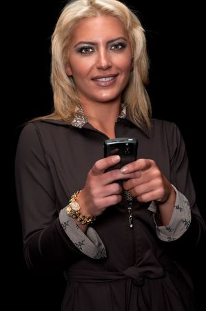 Young woman sending text message or email from pda. Stock Photo - 4768037