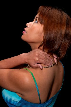 Young woman massaging herself because of a neck and back pain. Stock Photo - 4768034