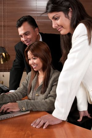 Group of coworkers looking at computer screen. Stock Photo - 4873936