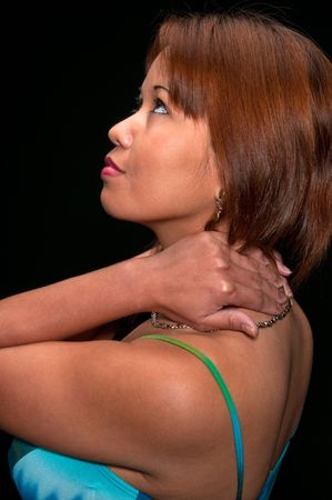 Young woman massaging herself because of a neck and back pain. Stock Photo - 4873914