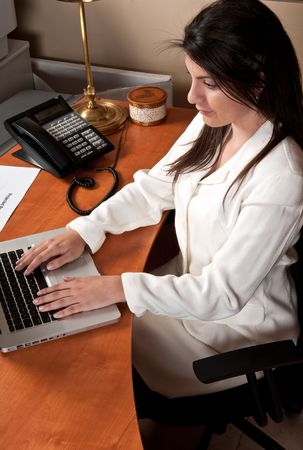 Young businesswoman working in the office in her computer. Stock Photo - 4893989