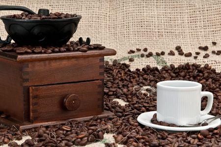 expresso: Cup of Expresso Coffee with old grinder and coffee beans. Stock Photo