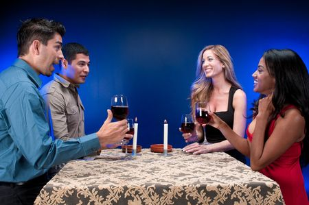 Group of friends drinking wine and celebrating. photo