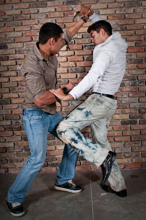 Young guys fighting in the street with knifes. Stock Photo - 4926638