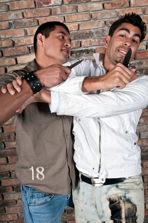 Young guys fighting in the street with knifes. Stock Photo - 4926636