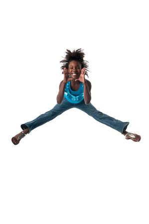 African american girl jumping very high and happy. photo