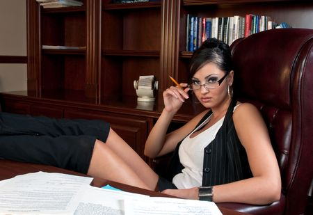 Beautiful and very sexy secretary working after hours. Stock Photo