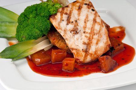 Plate of Mahi Mahi, severd with vegetables, pineapple and soy sauce. Stock Photo