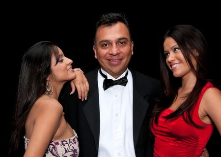40 something executive with tuxedo flirting with young girls. Stock Photo - 5185254