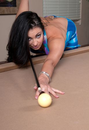 Very sexy girl playing pool and flirting. photo