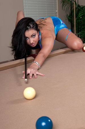 Very sexy girl playing pool and flirting. photo
