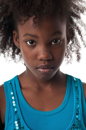 children sad: African American girl looking very serious at camera.