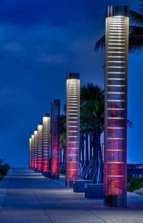 Lanters iluminating path to the beach at night in South Pointe Park, Miami Beach. Stock Photo - 5270385