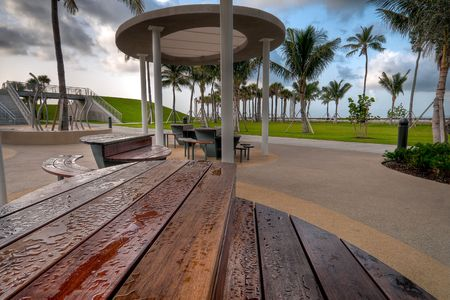 Picnic tables very early in the morning, at South Pointe Park, Miami Beach, Florida. photo