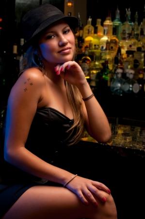 bar: Young woman in a nightclub bar, posing very sexy. Stock Photo