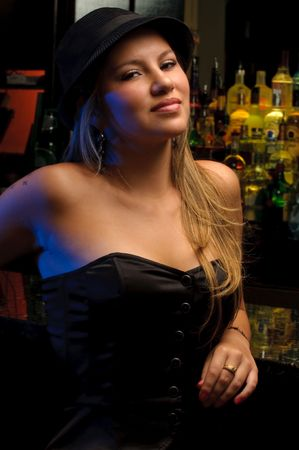 nightclub bar: Young woman in a nightclub bar, posing very sexy. Stock Photo