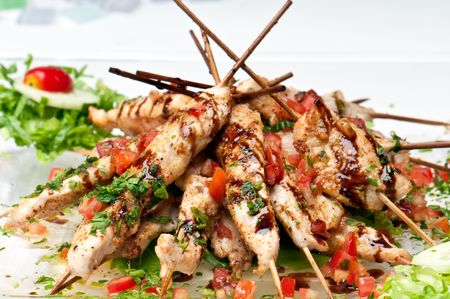 satay sauce: Plate full ok kabobs of chicken teriyaki presented for catering. Stock Photo