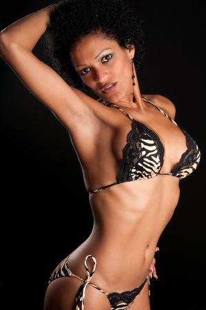 30 Something very sensual hispanic brunette woman in bikini. Stock Photo - 5353716