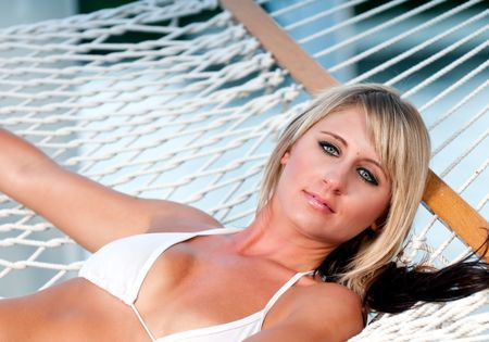 Very sensual caucasian girl resting in a hammock in the summer. photo