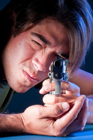 Young guy pointing with an automatic gun. Stock Photo - 5353723