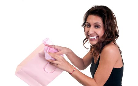 Young hispanic woman very happy receiving a present. photo