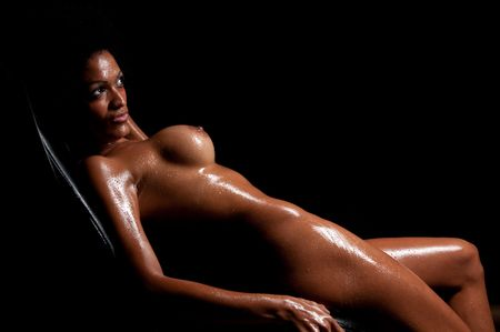 Young hispanic woman pasing nude and wet in dim light. Stock Photo - 5572498