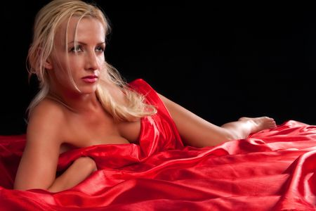 30 something caucasian woman very sexy and covered with red silk sheet. Stock Photo - 5644955