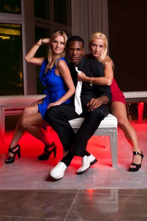 lounge: Young caucasian womans seated in a lounge with an African American man.