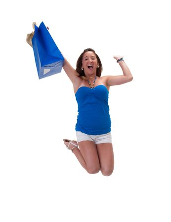 Young hispanic woman jumping high, very happy with shopping bag. photo