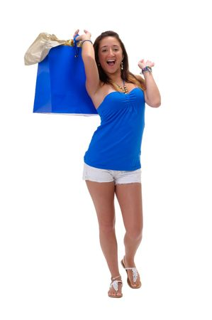 Young hispanic girl very happy with shopping bags. photo