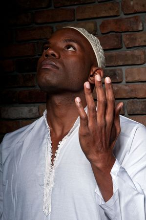 Young african american of muslim religion praying. photo