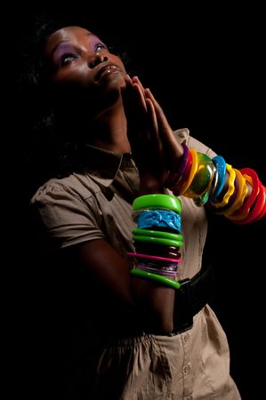 Young african american praying in dim light. Stock Photo - 5812898