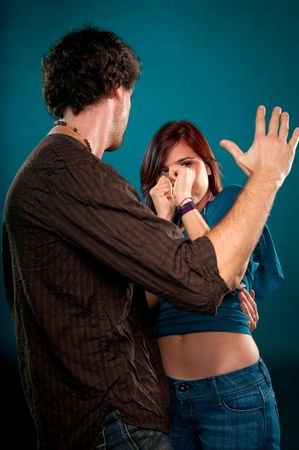 Young man punishing and attacking a young woman. photo