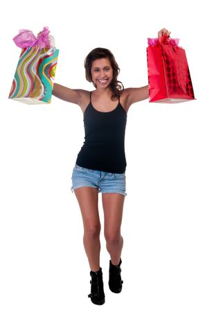 Young hispanic woman walking with shopping bags very happy. photo