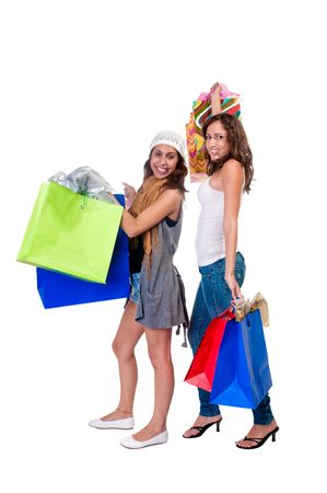 Young caucasian and hispanic girls with shopping bags very hsppy. photo