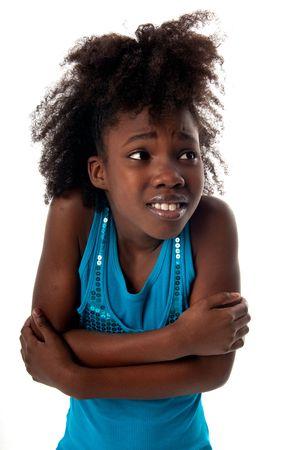scared child: Chica africano americana mirando mucho miedo.