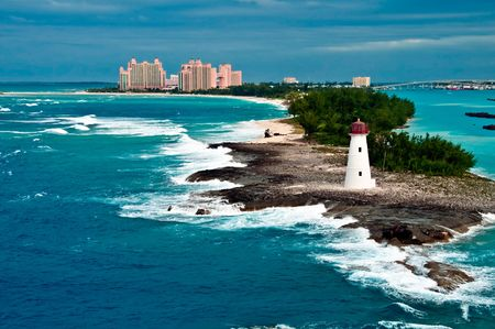 bahamas: View of lighthouse in Nassau, Bahamas and tourist resorts in the city,