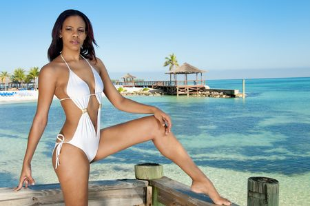 bahamian: Young bahamian woman enjoys the beach in a resort.