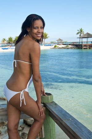 bahamian: Young bahamian woman enjoys the beach in the caribbean.