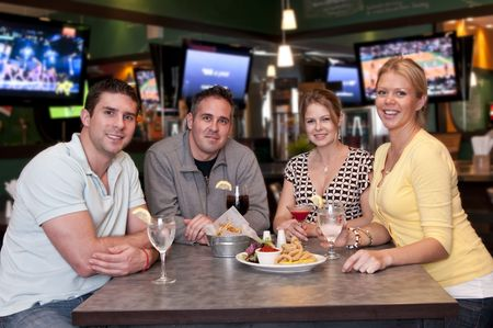 trendy: Group of friends having fun in a trendy bar. Stock Photo