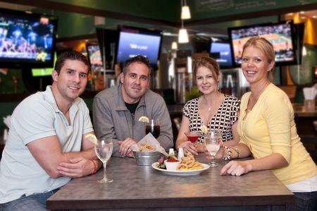 Group of friends having fun in a trendy bar. Archivio Fotografico