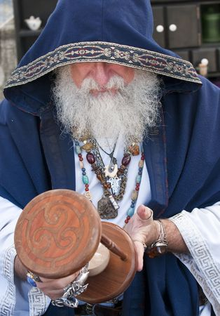 Old man, fortune teller looking at hour glass. photo