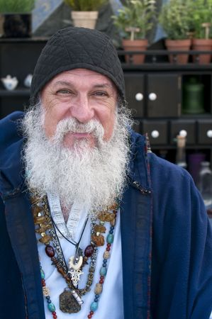 Old man, fortune teller smiling and looking at camera. photo