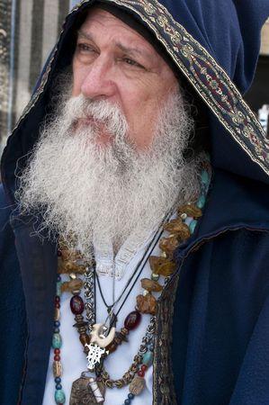 a beard: Old man, fortune teller very pensive